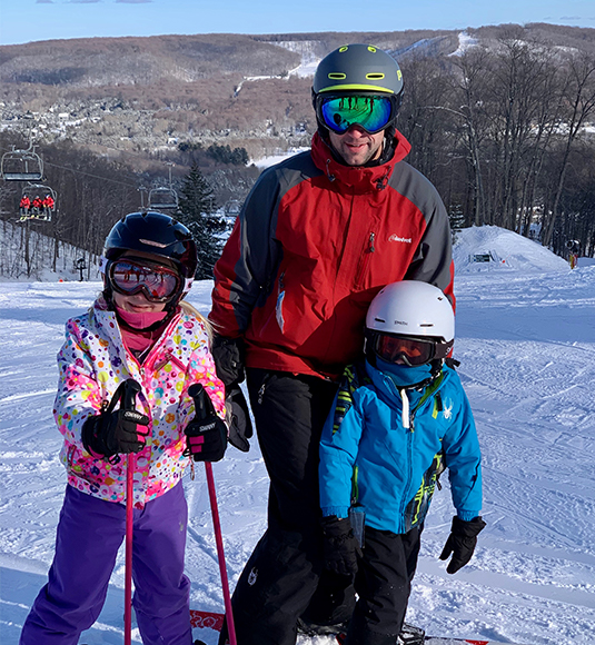 Jay Bryan skiing with family