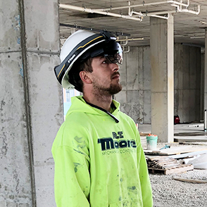 Construction worker wearing augmented reality headwear