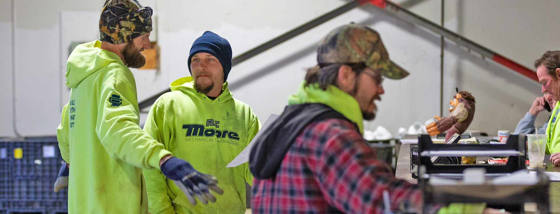 RT Moore employees having a conversation at work