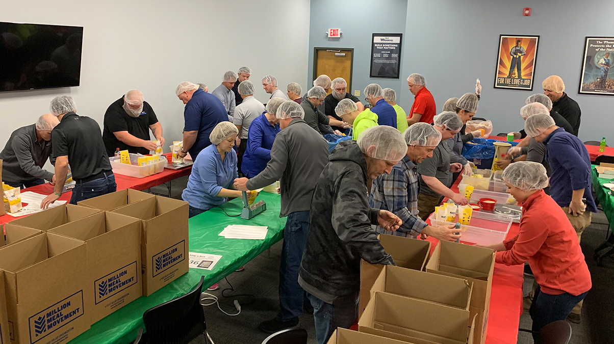 RT Moore employees volunteering at Million Meal Movement