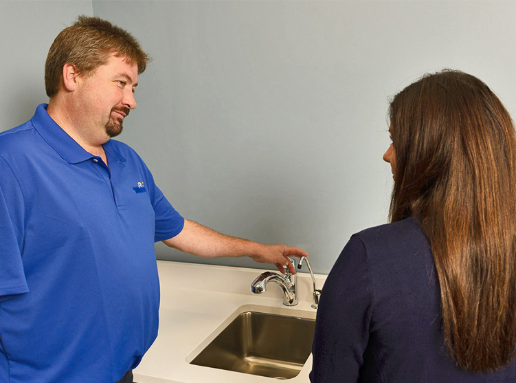 RT Moore plumber talking to a customer