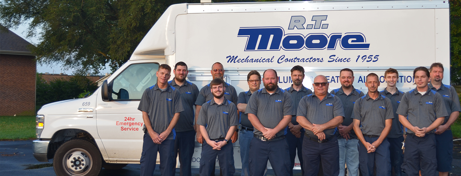 RT Moore Service Technician group photo in front of an RT Moore truck